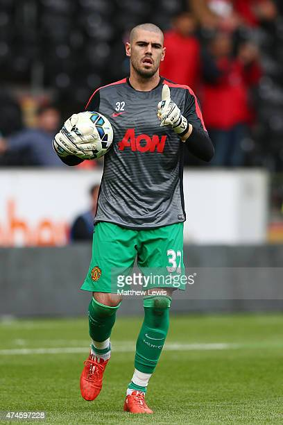 Victor Valdes of Manchester United warms up prior to the Barclays Premier League match between Hull City and Manchester United at KC Stadium on May...