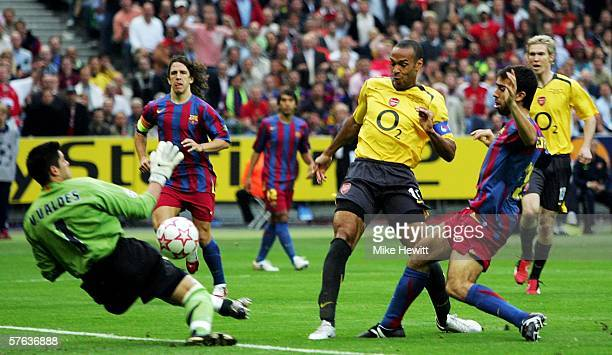 Victor Valdes the Barcelona goalkeeper saves from Thierry Henry of Arsenal during the UEFA Champions League Final between Arsenal and Barcelona at...