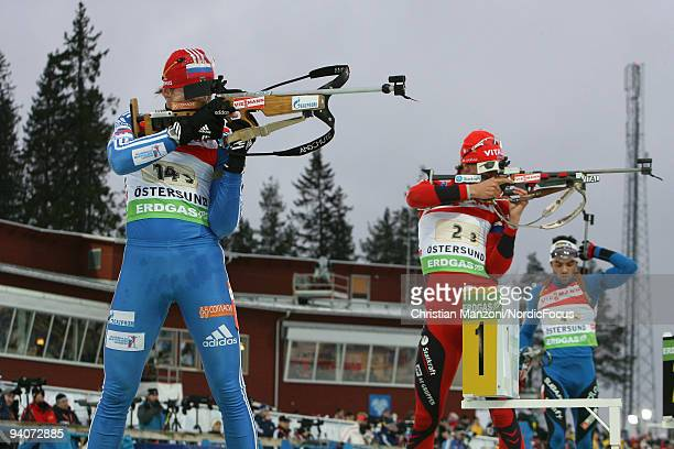 Victor Vasilyev of Russia Lars Berger of Norway and Simon Fourcade of France at the shooting range during the Men's 4x75 km Relay in the EON Ruhrgas...