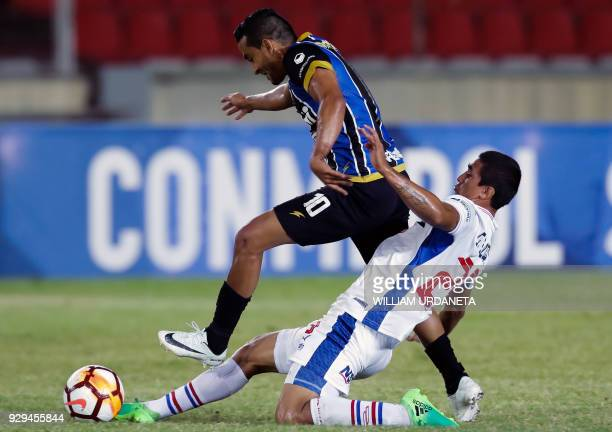 Victor Velazquez of Paraguay's Nacional vies for the ball with Louis Pena of Venezuela's Mineros during their Copa Sudamericana 2018 football match...