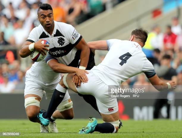 Victor Vito of Barbarians is tackled by Elliott Stooke of England during the Quilter Cup match between England and Barbarians at Twickenham Stadium...