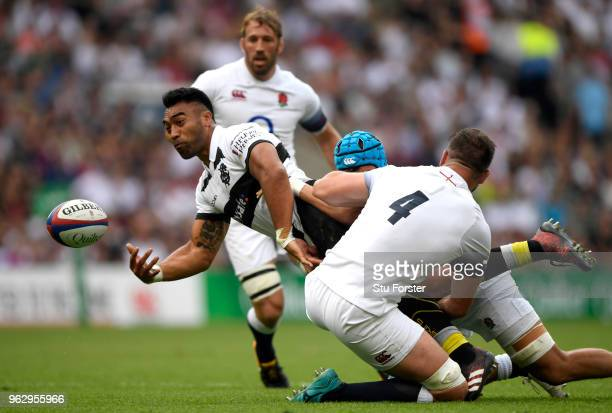 Victor Vito of Barbarians offloads the ball during the Quilter Cup match between England and Barbarians at Twickenham Stadium on May 27 2018 in...