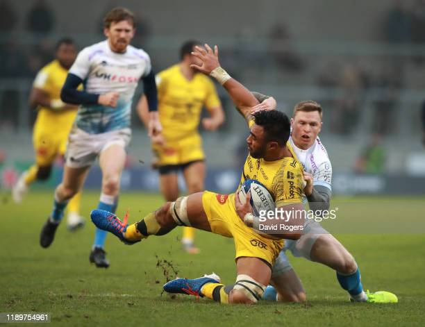 Victor Vito of La Rochelle is caught by Chris Ashton during the Heineken Champions Cup Round 2 match between Sale Sharks and La Rochelle at AJ Bell...