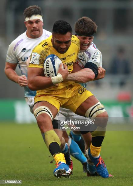 Victor Vito of La Rochelle is tackled by Ben Curry during the Heineken Champions Cup Round 2 match between Sale Sharks and La Rochelle at AJ Bell...