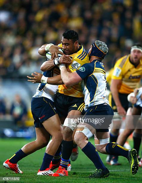 Victor Vito of the Hurricanes is tackled during the Super Rugby Semi Final match between the Hurricanes and the Brumbies at Westpac Stadium on June...
