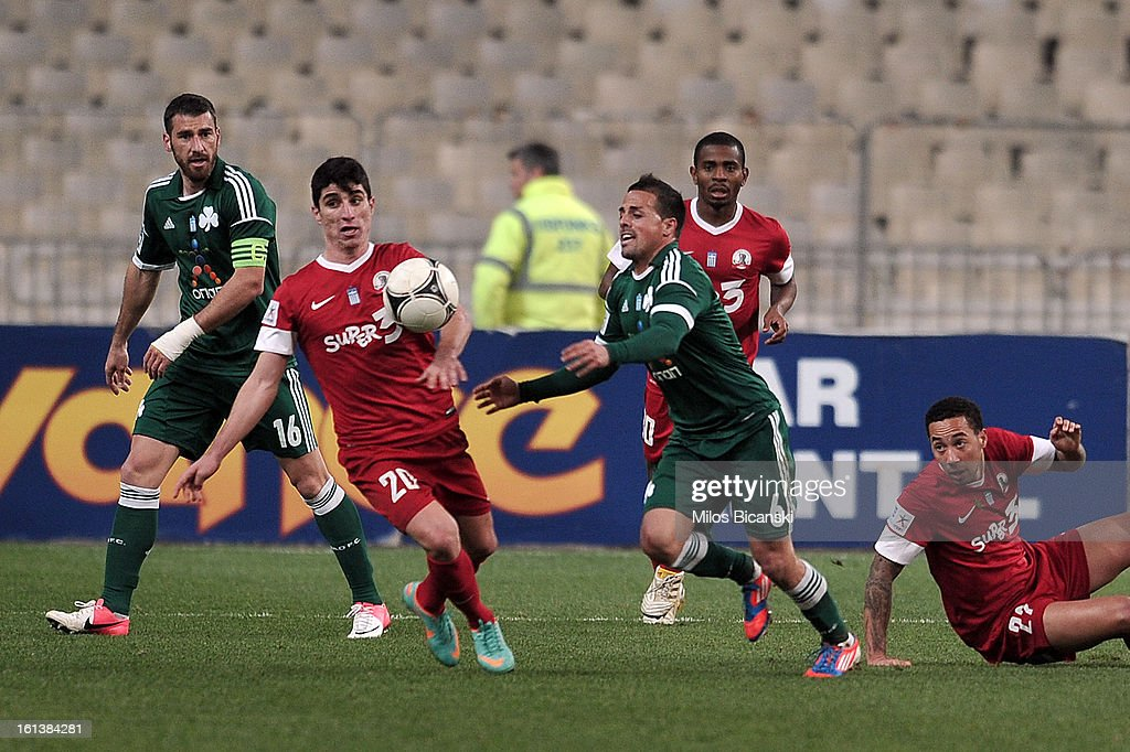Victor Vitolo of Panathinaikos FC competes for the ball with Mantalos Petros (R) of Skoda Xanthi during the Superleague match between Panathinaikos FC and Skoda Xanthi at OAKA Stadion on February 10, 2013 in Athens,Greece.