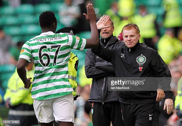 Victor Wanyama and Coach Neil Lennon of Celtic celebrate Wanyama scoring during the Clydesdale Bank Scottish Premier League match between Celtic and...