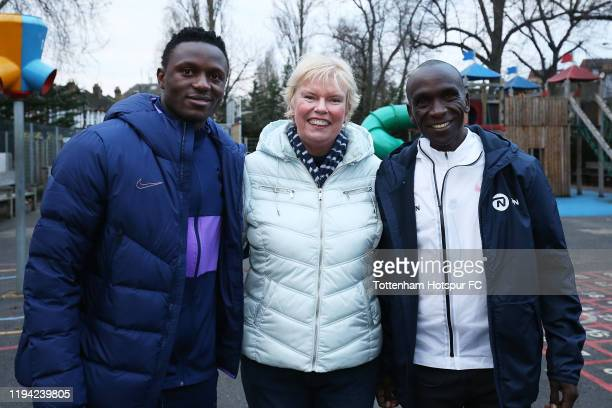 Victor Wanyama Elaine Wyllie MBE Founder of the Daily Mile and Eliud Kipchoge pose for a photo at Earlsmead Primary School to show support for the...