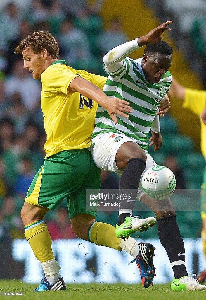 Victor Wanyama of Celtic and Chris Martin of Norwich City in action during the pre-season friendly match between Celtic and Norwich City, at ParkHead Stadium on July 24, 2012 in Glasgow, Scotland.