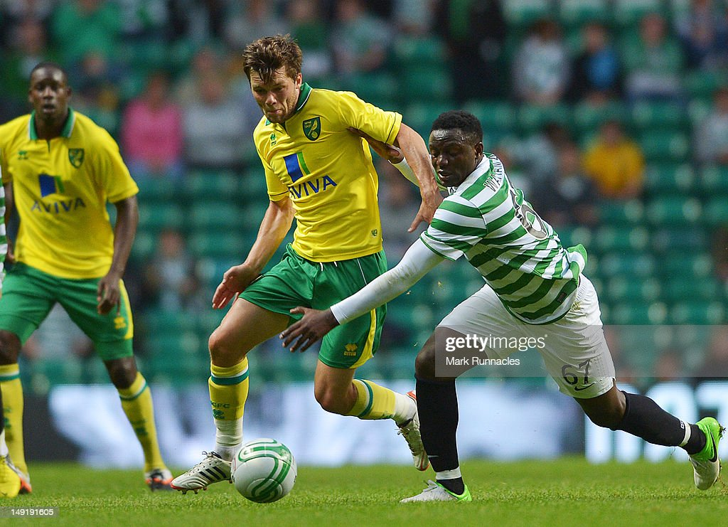 Victor Wanyama of Celtic and Jonathan Howson of Norwich City in action during the pre-season friendly match between Celtic and Norwich City, at ParkHead Stadium on July 24, 2012 in Glasgow, Scotland.