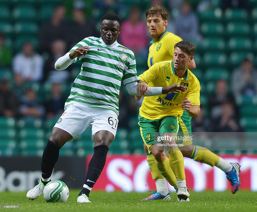 Victor Wanyama of Celtic and Wesley Hoolahan of Norwich City in action during the pre-season friendly match between Celtic and Norwich City, at ParkHead Stadium on July 24, 2012 in Glasgow, Scotland.