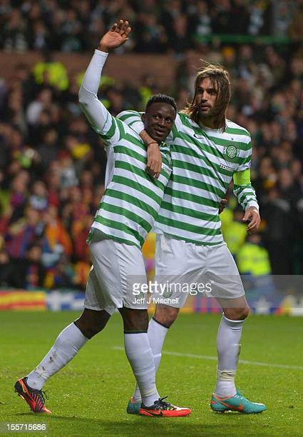Victor Wanyama of Celtic celebrates with teammate Giorgos Samaras after scoring during the UEFA Champions League Group G match between Celtic and...