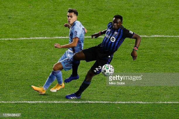 Victor Wanyama of Montreal Impact in action against Jesus Medina of New York City at Red Bull Arena on October 24, 2020 in Harrison, New Jersey.