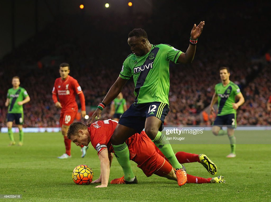 Victor Wanyama of Southampton and James Milner of Liverpool compete for the ball during the Barclays Premier League match between Liverpool and Southampton at Anfield on October 25, 2015 in Liverpool, England.