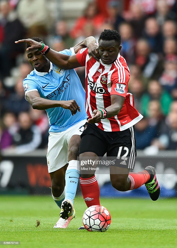 Victor Wanyama of Southampton and Kelechi Iheanacho of Manchester City tussle for the ball during the Barclays Premier League match between Southampton and Manchester City at St Mary's Stadium on May 1, 2016 in Southampton, England.