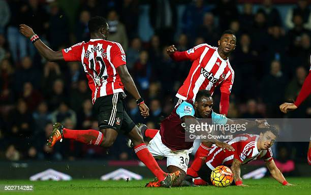 Victor Wanyama of Southampton attempts to clear the ball but is deflected off Michail Antonio of West Ham United for his side's first goal during the...