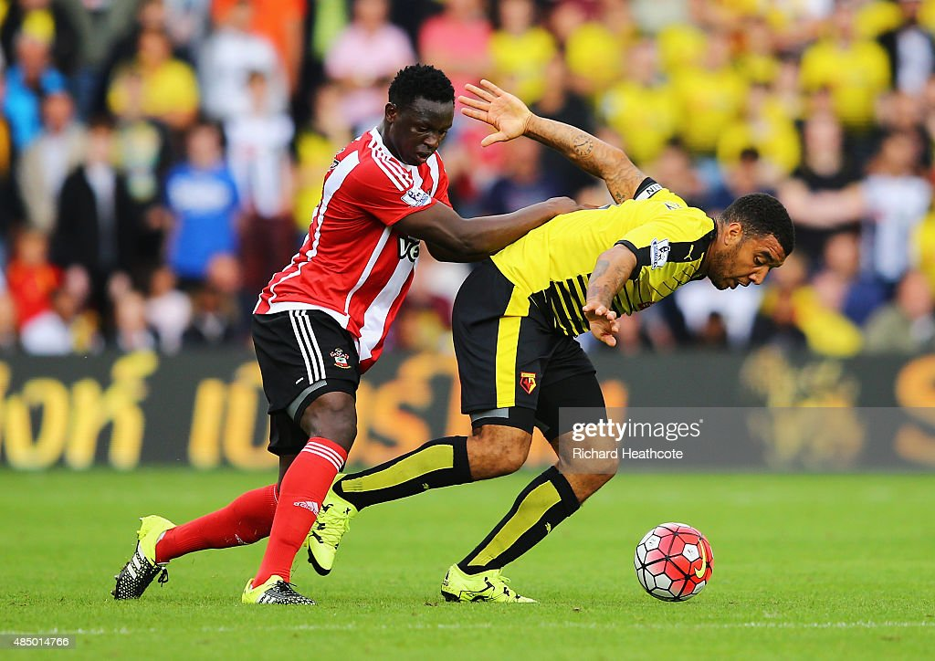 Victor Wanyama of Southampton challenges Troy Deeney of Watford during the Barclays Premier League match between Watford and Southampton at Vicarage Road on August 23, 2015 in Watford, England.