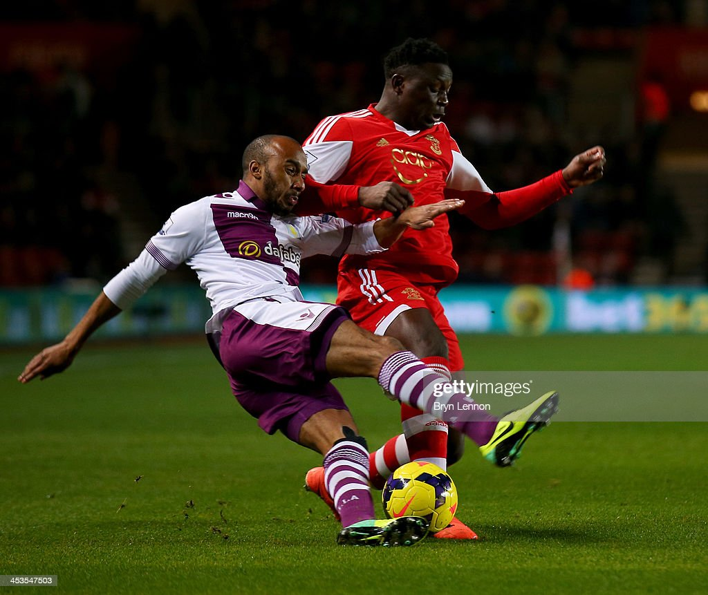 Victor Wanyama of Southampton holds off Fabian Delph of Aston Villa during the Barclays Premier League match between Southampton and Aston Villa at St Mary's Stadium on December 4, 2013 in Southampton, England.