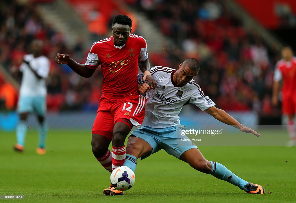 Victor Wanyama of Southampton is challenged by Winston Reid of West Ham during the Barclays Premier League match between Southampton and West Ham United at St Mary's Stadium on September 15, 2013 in Southampton, England.
