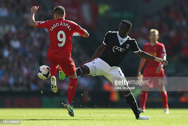 Victor Wanyama of Southampton tackles Iago Aspas of Liverpool during the Barclays Premier League match between Liverpool and Southampton at Anfield...