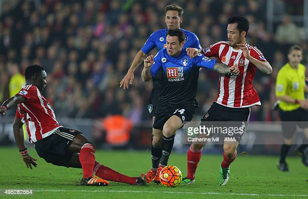 Victor Wanyama of Southampton tackles Lee Tomlin of Bournemouth and is subsequently shown a red card and sent off during the Barclays Premier League...