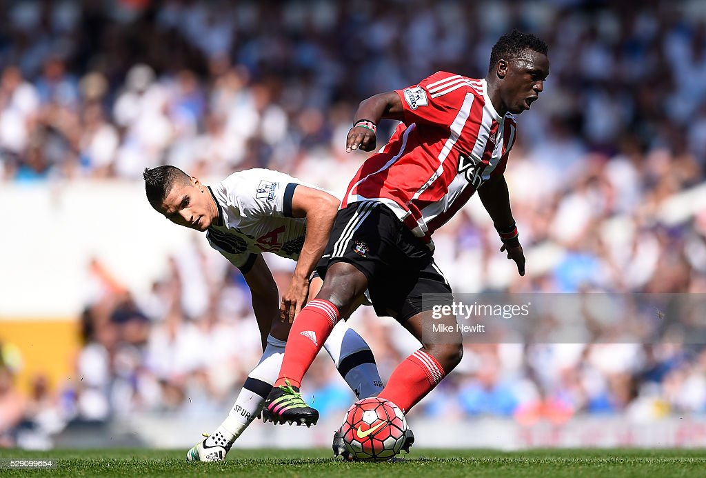 Victor Wanyama of Southampton takes on Erik Lamela of Tottenham Hotspur during the Barclays Premier League match between Tottenham Hotspur and Southampton at White Hart Lane on May 8, 2016 in London, England.