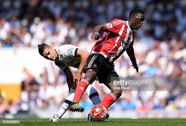 Victor Wanyama of Southampton takes on Erik Lamela of Tottenham Hotspur during the Barclays Premier League match between Tottenham Hotspur and...