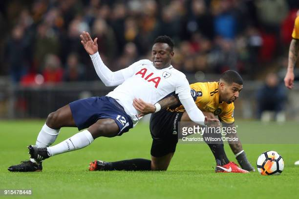 Victor Wanyama of Tottenham and Joss Labadie of Newport go down as they battle for the ball during The Emirates FA Cup Fourth Round Replay between...