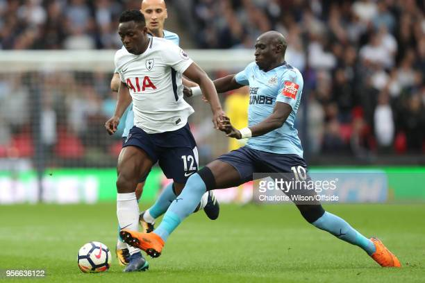 Victor Wanyama of Tottenham and Mohamed Diame of Newcastle battle for the ball during the Premier League match between Tottenham Hotspur and...