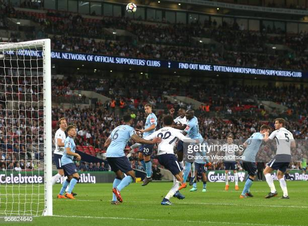 Victor Wanyama of Tottenham heads way over the bar during the Premier League match between Tottenham Hotspur and Newcastle United at Wembley Stadium...