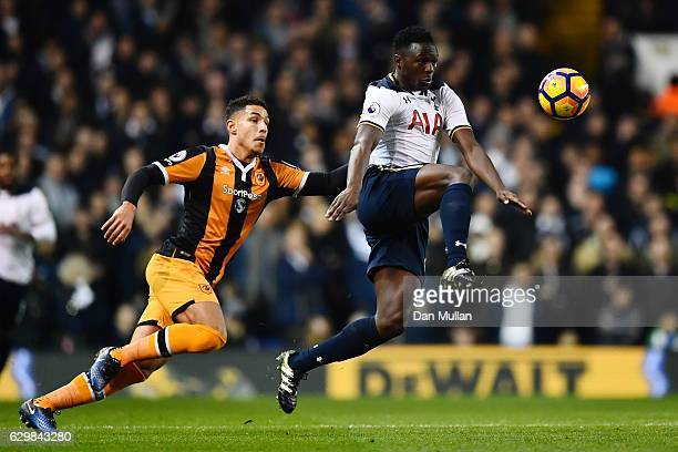 Victor Wanyama of Tottenham Hotspur and Jake Livermore of Hull City compete for the ball during the Premier League match between Tottenham Hotspur...