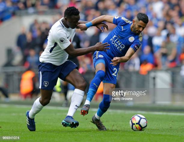 Victor Wanyama of Tottenham Hotspur and Riyad Mahrez of Leicester City fight for the ball during the Premier League match between Tottenham Hotspur...