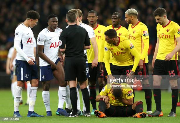 Victor Wanyama of Tottenham Hotspur appeals to the referee following being shown a yellow card as Jose Holebas of Watford checks if team mate...