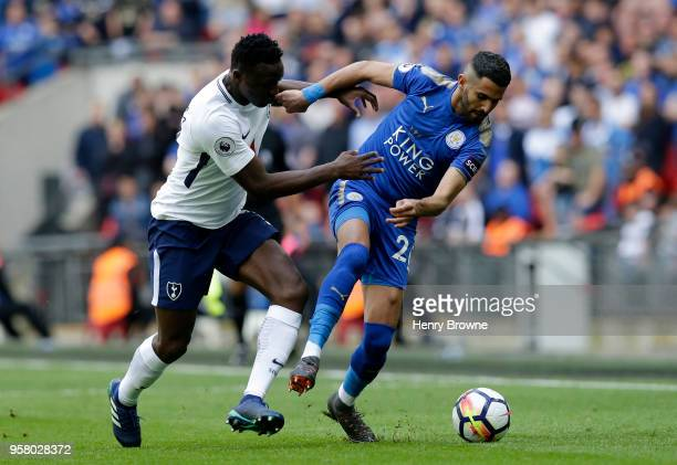 Victor Wanyama of Tottenham Hotspur battles for possession with Riyad Mahrez of Leicester City during the Premier League match between Tottenham...