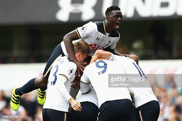 Victor Wanyama of Tottenham Hotspur celebrates after his team mate scores the first goal for their side during the Premier League match between...