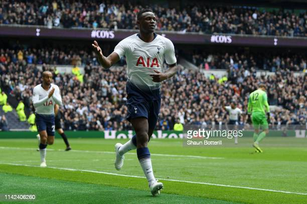 Victor Wanyama of Tottenham Hotspur celebrates after scoring his team's first goal during the Premier League match between Tottenham Hotspur and...