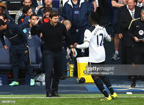 Victor Wanyama of Tottenham Hotspur celebrates scoring his sides first goal with Mauricio Pochettino Manager of Tottenham Hotspur during the Premier...