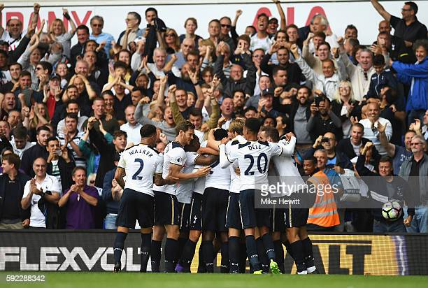 Victor Wanyama of Tottenham Hotspur celebrates scoring his sides first goal with his team mates during the Premier League match between Tottenham...