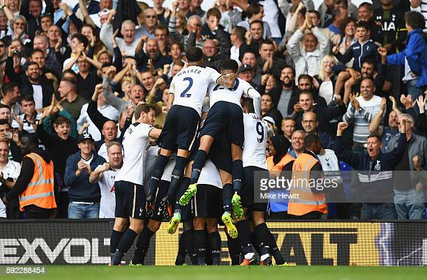 Victor Wanyama of Tottenham Hotspur celebrates scoring his sides first goal with team mates during the Premier League match between Tottenham Hotspur...