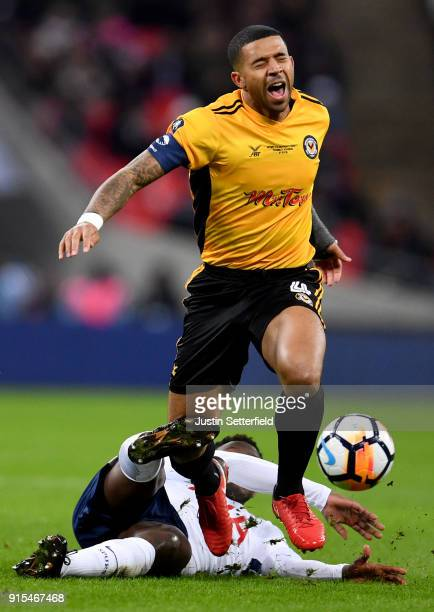 Victor Wanyama of Tottenham Hotspur fouls Joss Labadie of Newport County during The Emirates FA Cup Fourth Round Replay match between Tottenham...