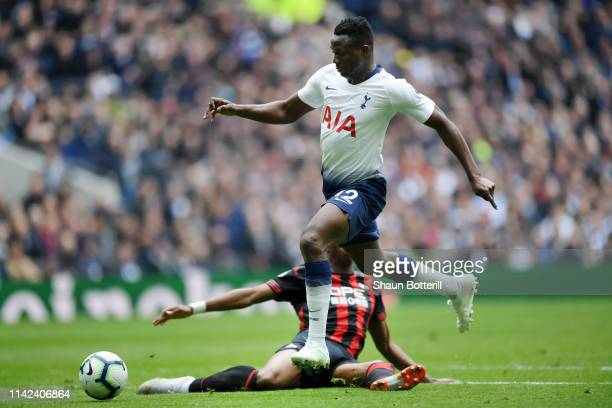 Victor Wanyama of Tottenham Hotspur goes around Terence Kongolo of Huddersfield Town and goes onto to score his sides first goal during the Premier...
