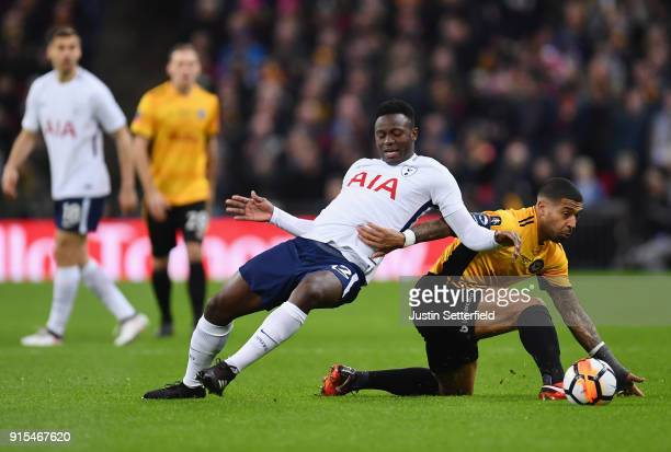 Victor Wanyama of Tottenham Hotspur is challenged by Joss Labadie of Newport County during The Emirates FA Cup Fourth Round Replay match between...
