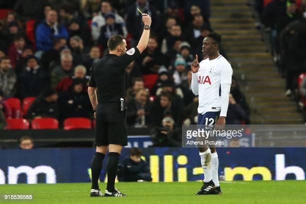 Victor Wanyama of Tottenham Hotspur receives a yellow card the Fly Emirates FA Cup Fourth Round Replay match between Tottenham Hotspur and Newport...