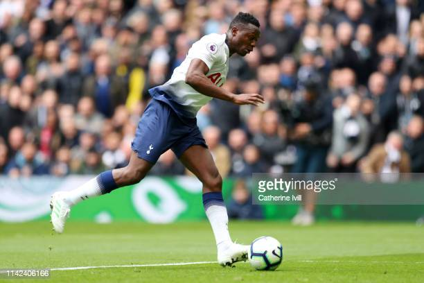 Victor Wanyama of Tottenham Hotspur scores his team's first goal during the Premier League match between Tottenham Hotspur and Huddersfield Town at...
