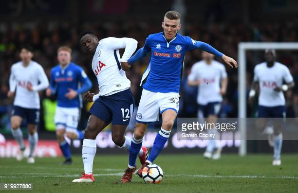 Victor Wanyama of Tottenham Hotspur tackles Mark Kitching of Rochdale AFC during The Emirates FA Cup Fifth Round match between Rochdale and Tottenham...