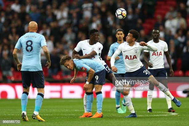 Victor Wanyama of Tottenham Hotspur wins a header over Dele Alli of Tottenam Hotspur and Dwight Gayle of Newcastle United during the Premier League...