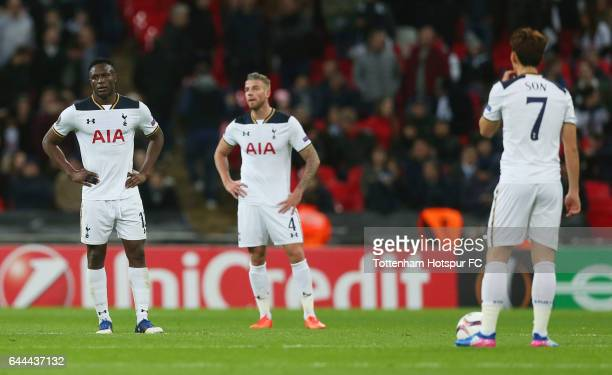 Victor Wanyama, Toby Alderweireld and Heung-Min Son of Tottenham Hotspur look dejected during the UEFA Europa League Round of 32 second leg match...