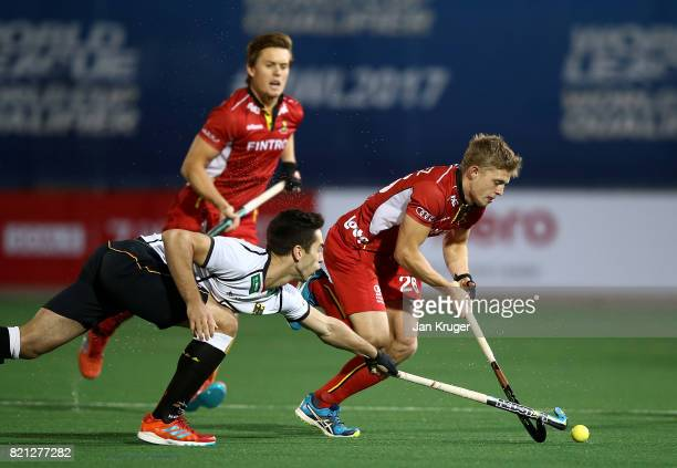 Victor Wegnez of Belgium battles with Lukas Windfeder of Germany during day 9 of the FIH Hockey World League Men's Semi Finals final match between...