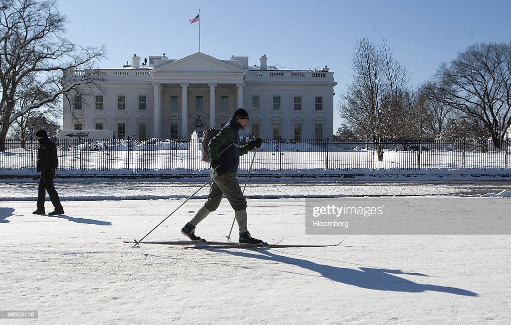 Victor Zabielski cross country skis past the White House in Washington, D.C. U.S., on Monday, Feb. 8, 2010. A new storm system barreling across the country may bring as much as 12 inches (30 centimeters) of snow to New York, Washington and Baltimore starting late tomorrow, forecasters said. Photographer: Andrew Harrer/Bloomberg via Getty Images