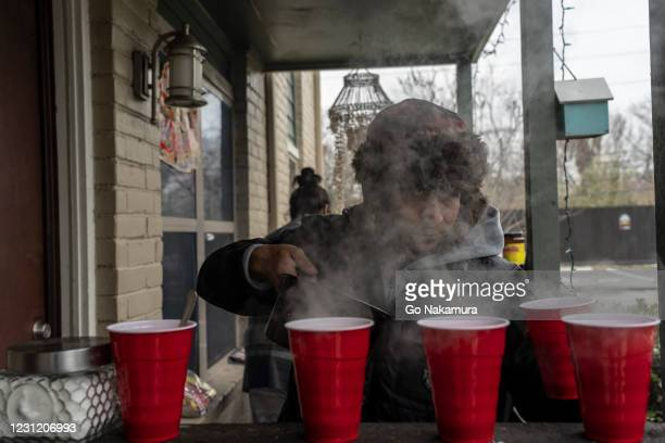 Victor Zelaya makes hot coffee for his room mates during power outage caused by the winter storm on February 16, 2021 in Houston, Texas. Winter storm...